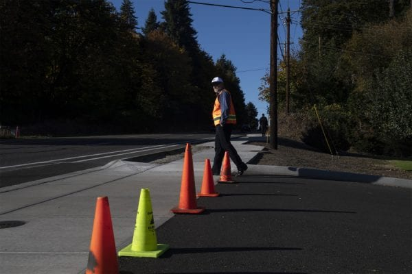 Improved section of HWY 99 features new sidewalk made with pervious concrete that allows rain to drain through the pavement